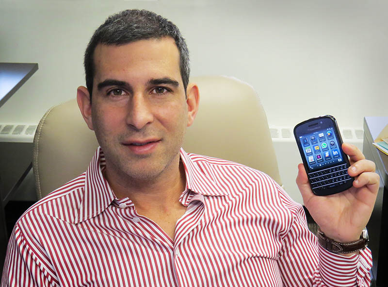 Lawyer Isaac Ziskind holding a BlackBerry Q10