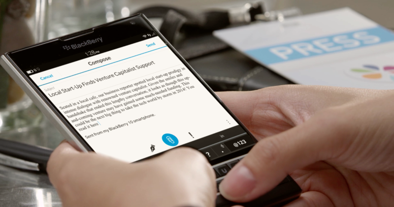 Image of someone typing on a BlackBerry Passport