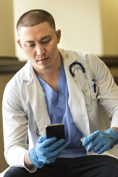 male-doc-with-phone