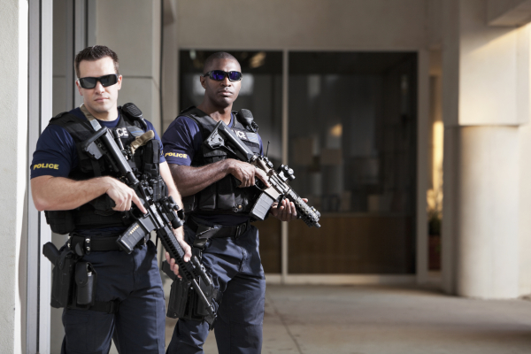 Police officers with rifles